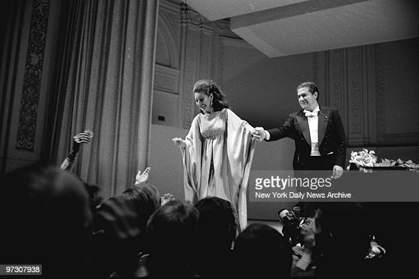Soprano Maria Callas steps forward to receive the cheers of audience after comeback appearance with tenor Giuseppie de Stefano at Carnegie Hall Maria...