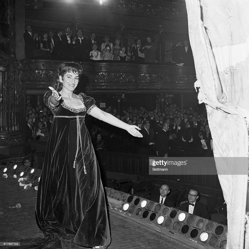 Soprano Maria Callas walking offstage after a performance.