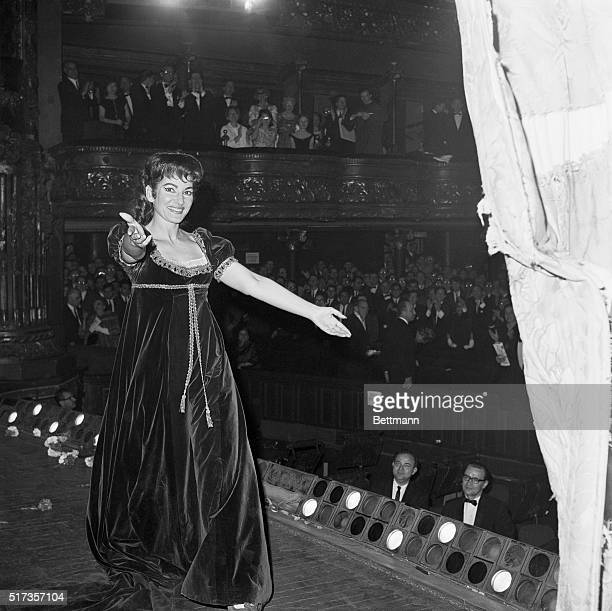 Soprano Maria Callas walking offstage after a performance