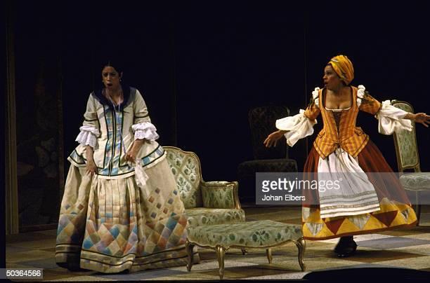 Soprano Maria Ewing as Dorabella soprano Kathleen Battle as Despina in a scene fr Mozart's Cosi FanTutti on stage at the Metropolitan Opera