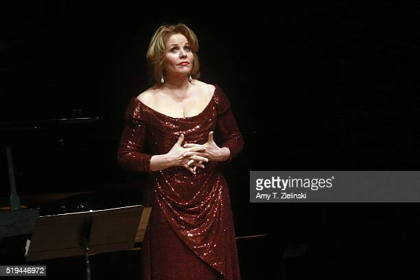 Soprano Renee Fleming pauses as she is accompanied by Hartmut Holl on piano singing works by composers Schumann Rachmaninov Barber and Strauss in...