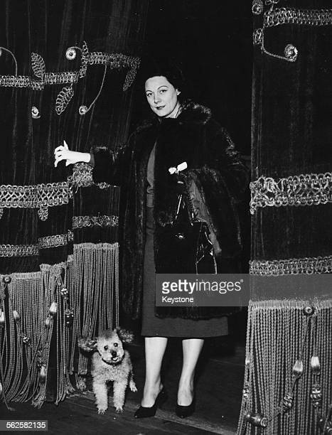 Soprano singer Renata Tebaldi pictured with her pet dog on the stage of Teatro Alla Scala opera house the first time she has been there in four years...