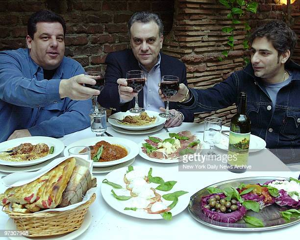 Sopranos actors lr Steve Schirripa Vince Curatola Michael Imperioli dining at Il Cortile on Mulberry St