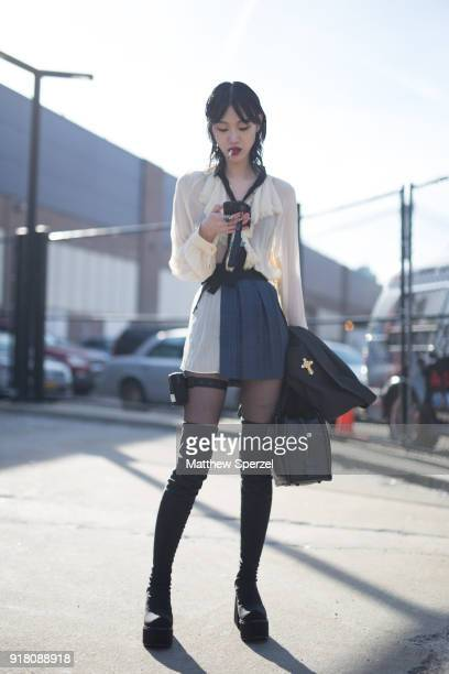 Sora Choi is seen on the street attending Coach 1941 during New York Fashion Week wearing Coach on February 13 2018 in New York City