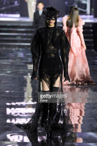 Sora Choi walks the CR Runway x LuisaViaRoma at Piazzale Michelangelo during the Pitti Immagine Uomo 96 on June 13 2019 in Florence Italy