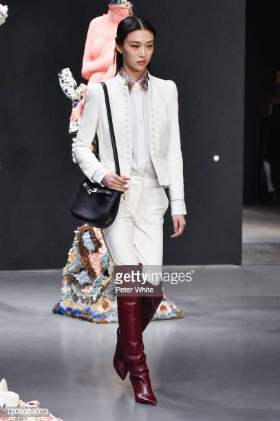 Sora Choi walks the runway during the Tory Burch Fall Winter 2020 Fashion Show at Sotheby's on February 09, 2020 in New York City.