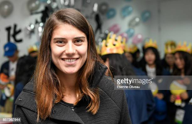 Sorana Cirstea of Romania attends volunteer's birthday at the Volunteer Home on day five of the 2017 China Open at the China National Tennis Centre...