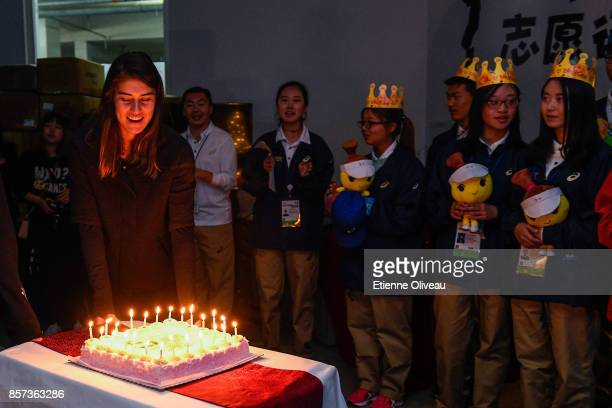 Sorana Cirstea of Romania brings a birthday cake at the Volunteer Home on day five of the 2017 China Open at the China National Tennis Centre on...