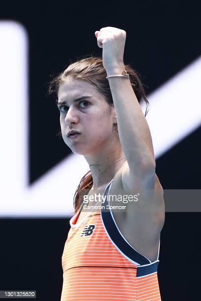 Sorana Cirstea of Romania celebrates after winning a point in her Women's Singles second round match against Petra Kvitova of Czech Republic during...