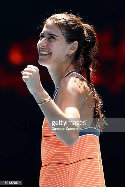 Sorana Cirstea of Romania celebrates after winning match point in her Women's Singles second round match against Petra Kvitova of Czech Republic...