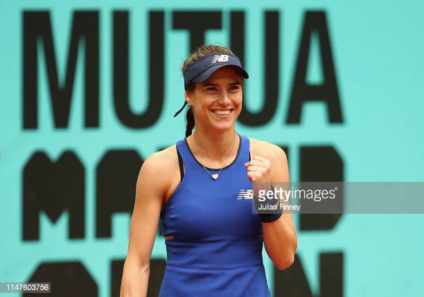 Sorana Cirstea of Romania celebrates against Caroline Garcia of France during day four of the Mutua Madrid Open at La Caja Magica on May 07 2019 in...
