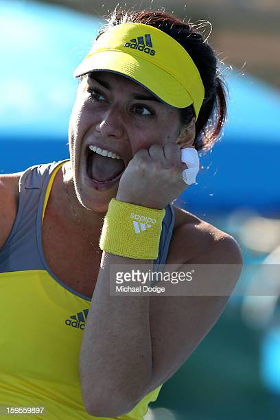 Sorana Cirstea of Romania celebrates in her second round match against Kristyna Pliskova of the Czech Republic during day three of the 2013...