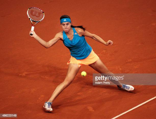 Sorana Cirstea of Romania hits a forehand during her match against Julia Goerges of Germany during day 3 of the Porsche Tennis Grand Prix 2014 at...