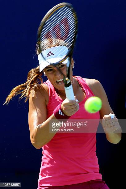 Sorana Cirstea of Romania hits a return against Sofia Arvidsson of Sweden during her first round women's singles match on day two of the 2010 U.S....