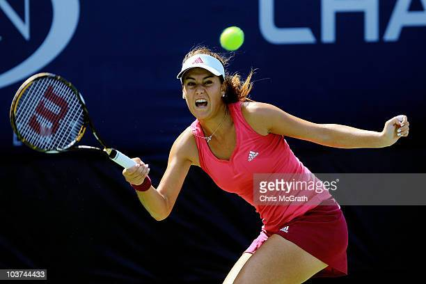 Sorana Cirstea of Romania hits a return against Sofia Arvidsson of Sweden during her first round women's singles match on day two of the 2010 US Open...