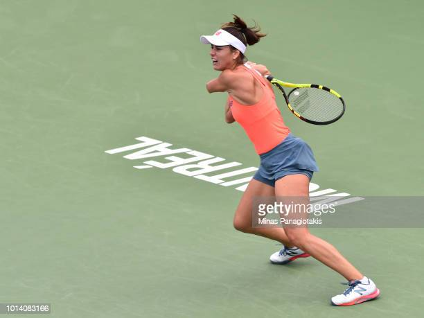 Sorana Cirstea of Romania hits a return against Venus Williams during day four of the Rogers Cup at IGA Stadium on August 9 2018 in Montreal Quebec...