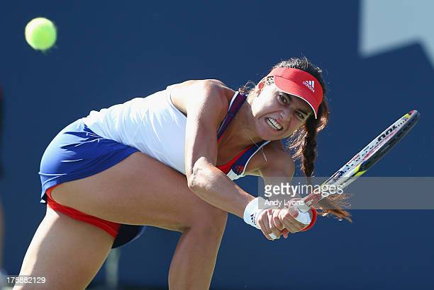 Sorana Cirstea of Romania hits a return during her 46 75 62 win over Petra Kvitova of the Caech Republic during the Rogers Cup Toronto on day 5 at...