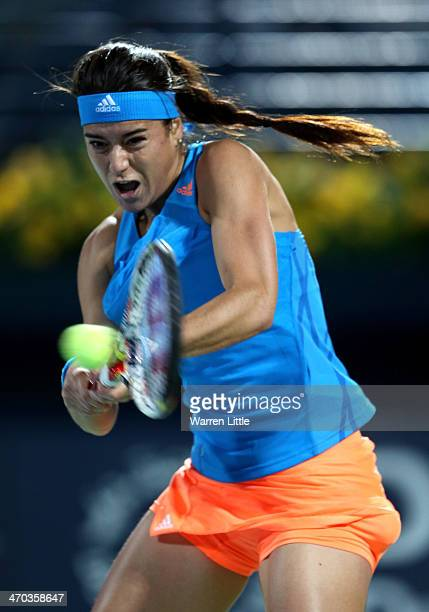Sorana Cirstea of Romania in action against Sara Errani of Italy during day three of the WTA Dubai Duty Free Tennis Championship at the Dubai Tennis...