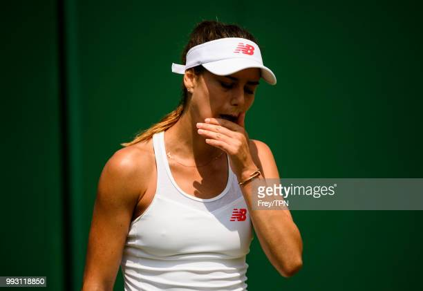 Sorana Cirstea of Romania looks frustrated against Evgeniya Rodina of Russia in the second round of the Ladies Singles at the All England Lawn Tennis...