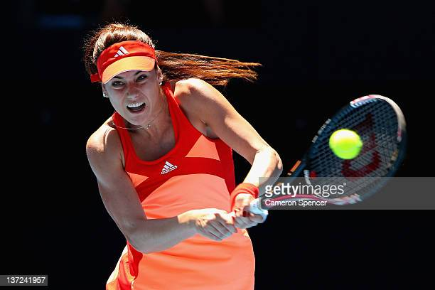 Sorana Cirstea of Romania plays a backhand in her first round match against Samantha Stosur of Australia during day two of the 2012 Australian Open...