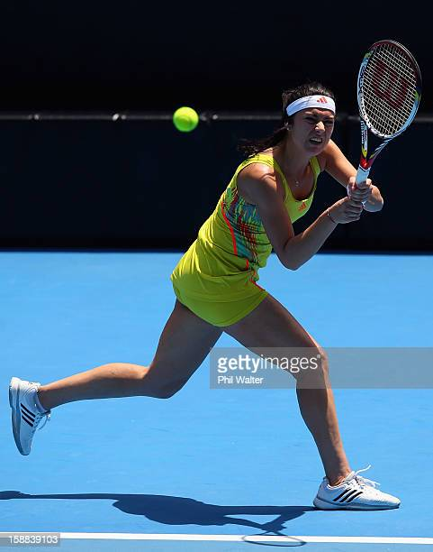 Sorana Cirstea of Romania plays a backhand in her first round match against Heather Watson of Great Britain during day two of the 2013 ASB Classic on...