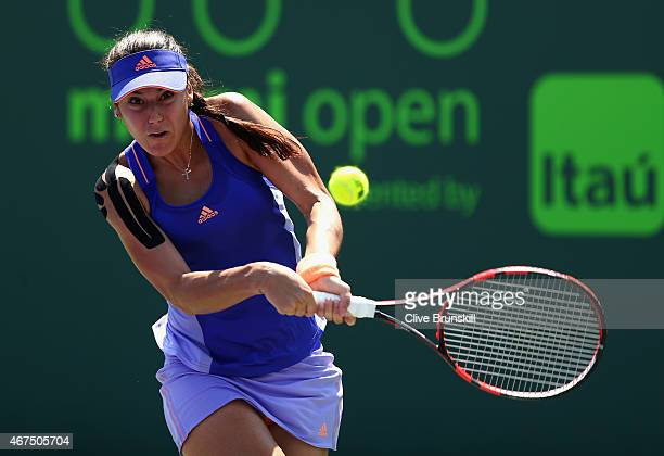 Sorana Cirstea of Romania plays a backhand to Christina McHale of the United States in their first round match during the Miami Open at Crandon Park...