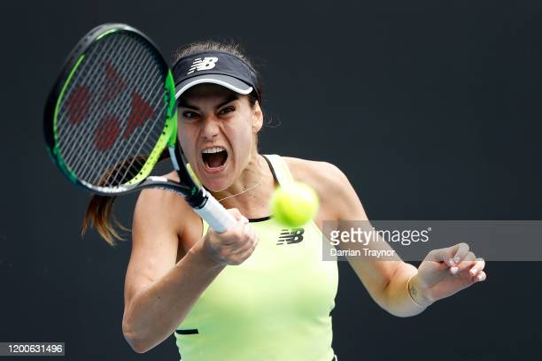Sorana Cirstea of Romania plays a forehand during her Women's Singles first round match against Barbora Strycova of Czech Republic on day one of the...