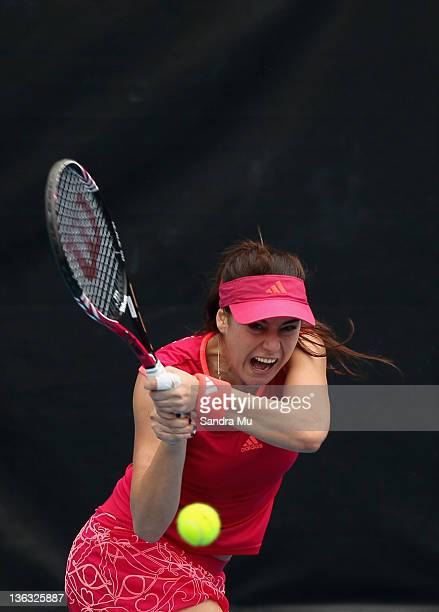 Sorana Cirstea of Romania plays a shot in her match against Flavia Pennetta of Italy during day one of the 2012 ASB Classic at ASB Tennis Centre on...