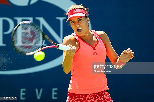 Sorana Cirstea of Romania returns a shot against Yanina Wickmayer of Belgium during Day Two of the 2011 US Open at the USTA Billie Jean King National...