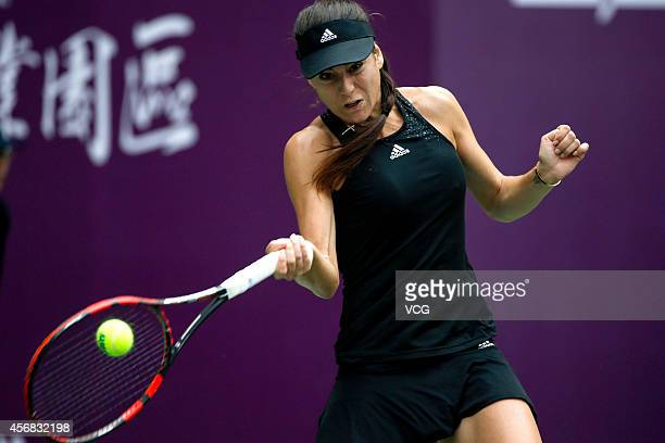 Sorana Cirstea of Romania returns a shot in her match against Andrea Hlavackova of the Czech Republic during day three of the WTA Tianjin Open at...