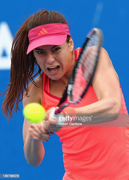 Sorana Cirstea of Romania returns a shot to Angelique Kerber of Germany during day five of the 2012 Hobart International at Domain Tennis Centre on...