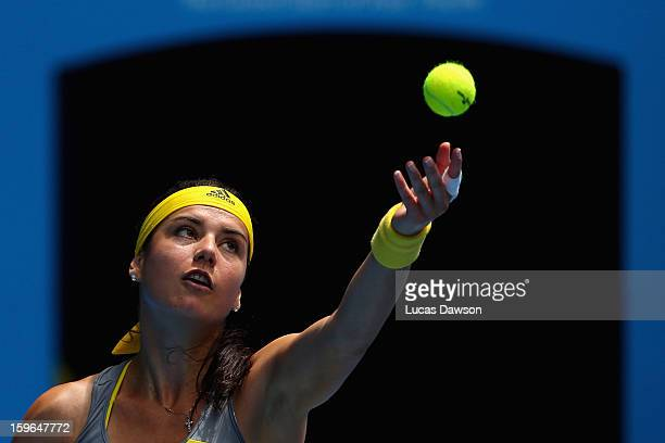 Sorana Cirstea of Romania serves in her third round match against Na Li of China during day five of the 2013 Australian Open at Melbourne Park on...