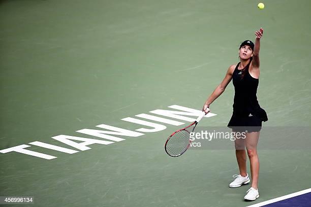 Sorana Cirstea of Romania serves in the quarter-final match against Zheng Saisai of China during day five of Tianjin Open at Tianjin Tuanbo...