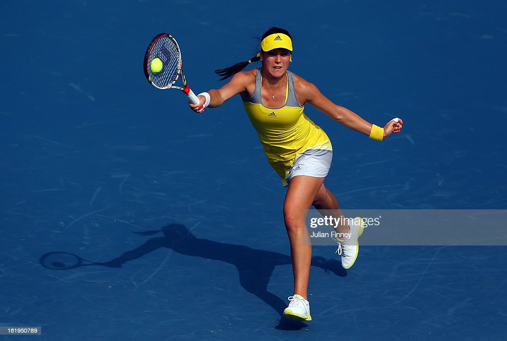 Sorana Cirstea of Romania stretches for a forehand in her match against Sloane Stephens of USA during day one of the WTA Dubai Duty Free Tennis Championship on February 18, 2013 in Dubai, United Arab Emirates.