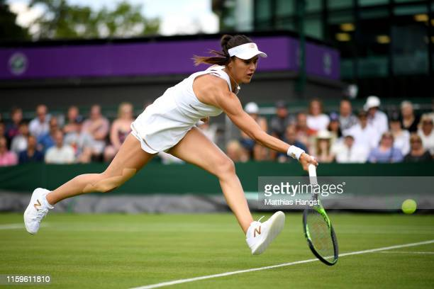 Sorana Cirstea of Romania stretches to play a forehand during Day two of The Championships Wimbledon 2019 at All England Lawn Tennis and Croquet Club...