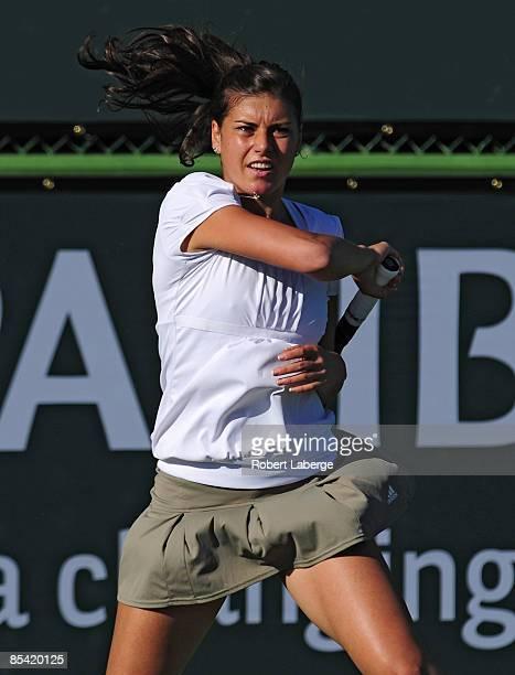 Sorana Cirstea returns to Elena Vesnina at the BNP Paribas Open at the Indian Wells Tennis Garden on March 13, 2009 in Indian Wells, California.