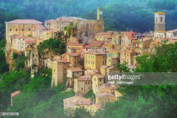 sorano, a town built on a tuff rock, is one of the most beautiful villages in italy - grosseto province stock photos and pictures