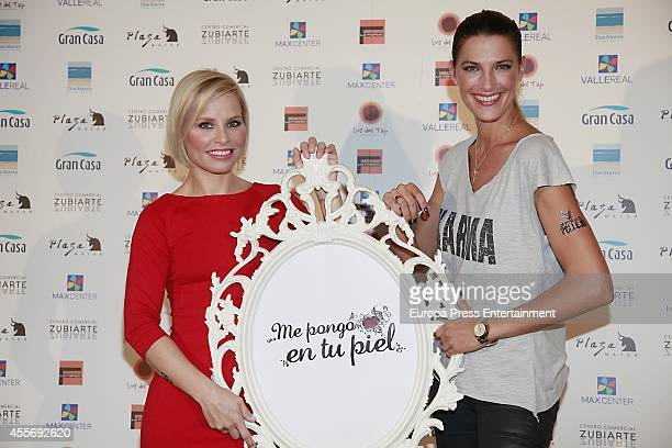 Soraya Arnelas and model Laura Sanchez get charity tatoos during the campaign against cancer 'Me Pongo En Tu Piel' on September 18 2014 in Madrid...