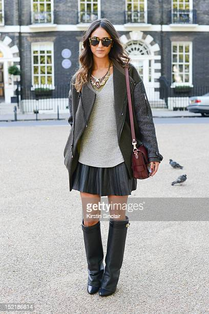 Soraya Bakhtiar fashion blogger, wearing Givenchy boots, Zara necklace and skirt, Topshop jacket, Proenza Schouler bag, isabel Marrant Top and...