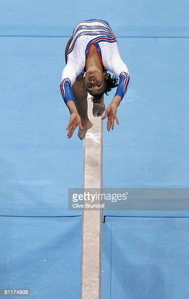 Soraya Chaouch of France competes in the beam in the qualification round of the team event at the women's artistic gymnastics competition on August...