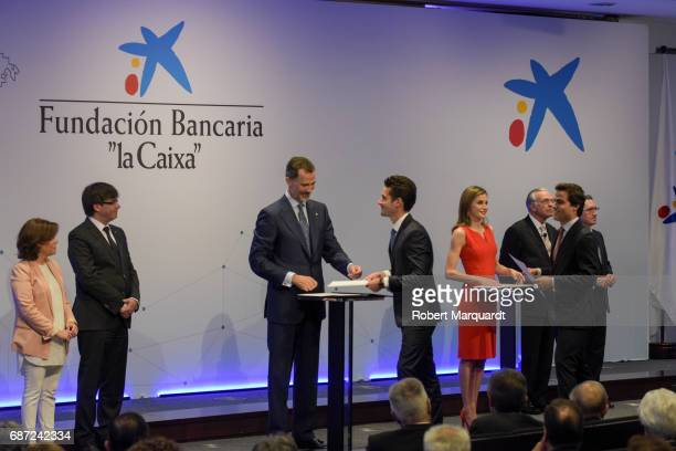 Soraya Saenz de Santamaria Carles Puigdemont King Felipe VI of Spain and Queen Letizia of Spain attend the 'La Caixa' Scholarships held at the...