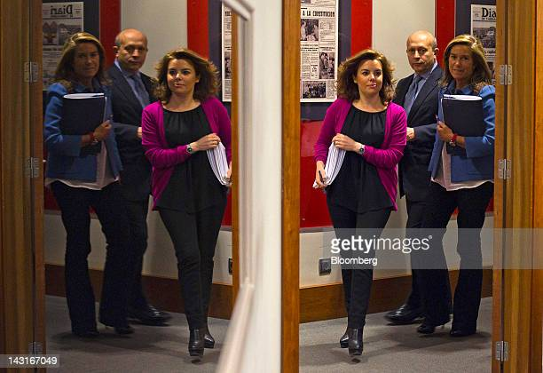 Soraya Saenz de Santamaria Spain's deputy prime minister left arrives with Jose Ignacio Wert Spain's education minister center and Ana Mato Spain's...