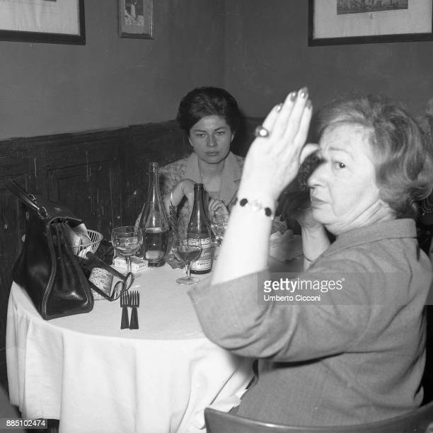 Soraya with her mother eating at the famous place 'San Callisto' Rome 1963