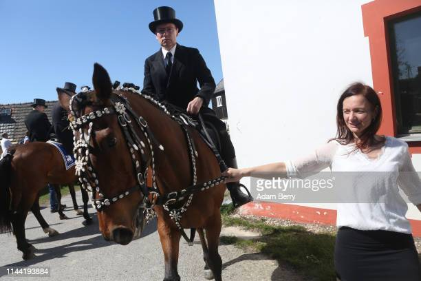 Sorb Easter horseman is assisted in guiding his horse during an annual procession on April 21 2019 in Siebitz Germany Sorbs a Slavic minority in...