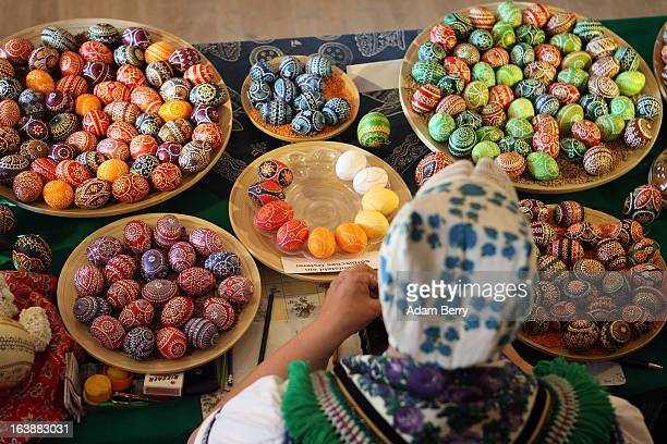 Sorb egg painter Kerstin Hanusch decorates eggs at the annual Easter egg market on March 16 2013 in Schleife Germany Easter is a particularly...