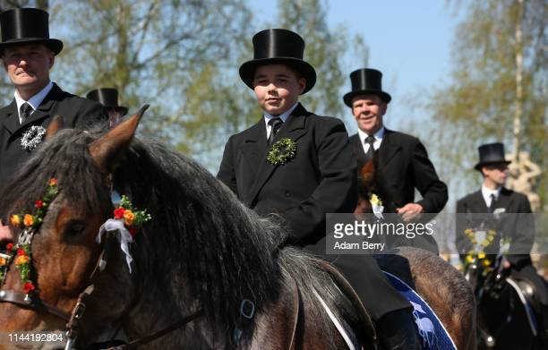 Sorb horsemen ride in an annual procession on April 21 2019 in Siebitz Germany Sorbs a Slavic minority in eastern Germany celebrate Easter with...