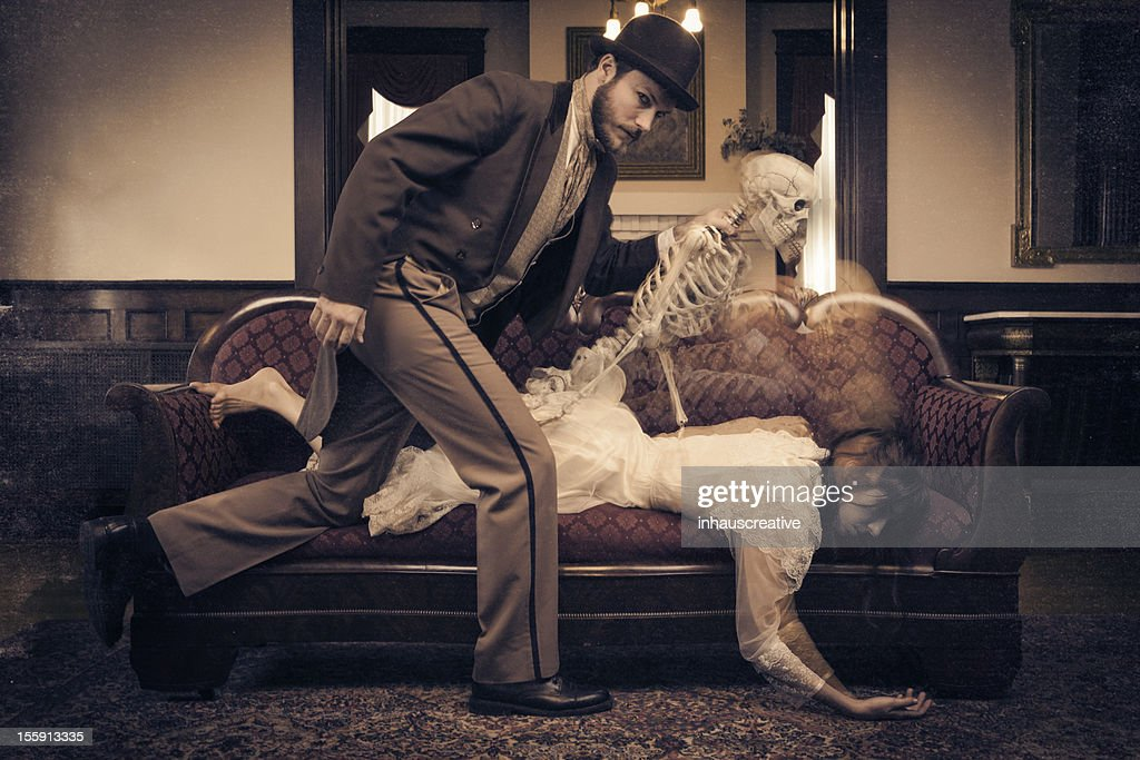 Sorcerer taking woman's soul from her : Stock Photo