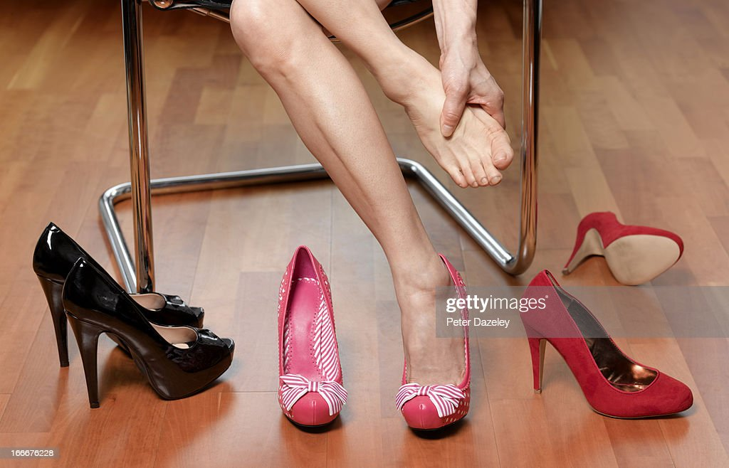 Sore feet trying on shoes : Stock Photo