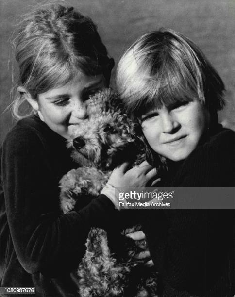 Soren Blau and Alexandra McCardle with their dog Noopy enjoy the sunshine in Centennial Park today The two young ladies are from Cremorne June 16 1978