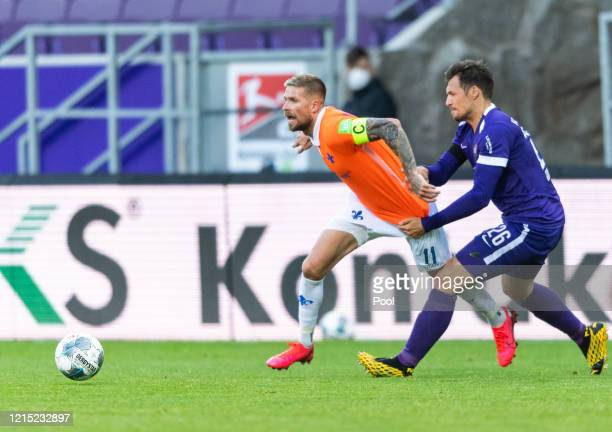 Soren Gonther of FC Erzgebirge Aue battles for possession with Tobias Kempe of Darmstadt during the Second Bundesliga match between FC Erzgebirge Aue...
